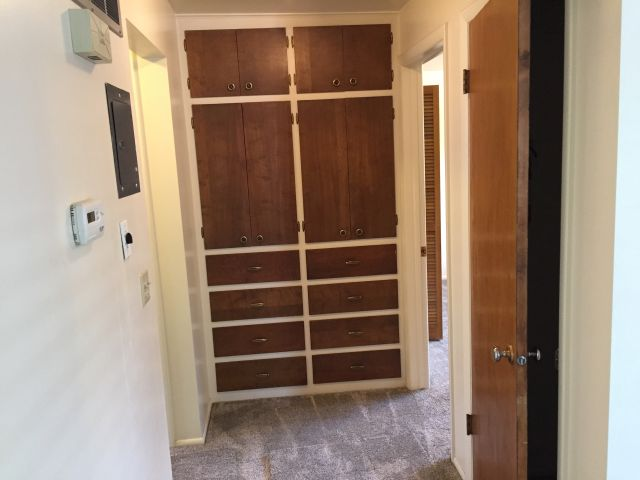 Hall built-in cabinets & coat closet